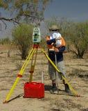Surveyor in desert. Surveyor working at work in desert heat. Queensland, Australia royalty free stock photography