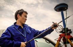Surveyor. Engineer surveyor adjusts the device to determine the coordinates. South Kazakhstan region, in June 2015 stock images