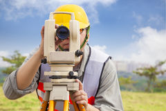 Surveyor engineer making measure data Royalty Free Stock Photos