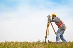 Surveyor engineer making measure. On the field stock image