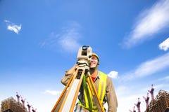 Surveyor engineer making measure on the field royalty free stock image