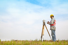 Surveyor engineer making measure. On the field with tablet pc stock images