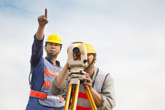 Surveyor engineer making measure with partner Stock Image