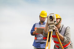 Surveyor engineer making measure with tablet pc Royalty Free Stock Images
