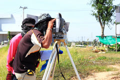 Surveyor engineer making measuring. With optical equipment  theodolite Stock Photos