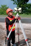 Surveyor or Engineer setting measure prism reflector on the highway. Surveyor or Engineer setting measure prism reflector on the highway in a field stock images