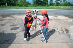 Surveyor or Engineer setting prism reflector with partner on the field. Surveyor or Engineer setting measure by prism reflector with partner on the field royalty free stock photos
