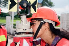 Surveyor or Engineer setting prism reflector with partner on the field. Surveyor or Engineer setting measure by prism reflector with partner on the field royalty free stock photo