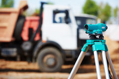Surveyor equipment at construction site Royalty Free Stock Photo