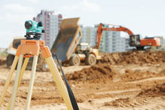 Surveyor equipment level at construction site Stock Image