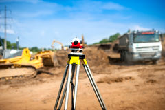 Surveyor equipment optical level or theodolite at construction Stock Photography