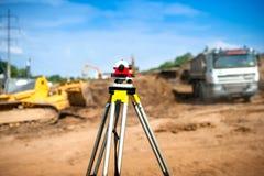 Surveyor equipment optical level or theodolite at construction Stock Photography