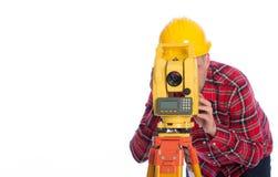 Surveyor equipment optical level in white background Royalty Free Stock Photos