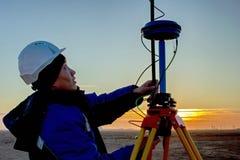 Surveyor. Surveyor equipment sets in the morning in the desert stock photos