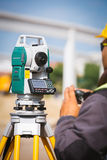 Surveyor equipment tacheometer or theodolite outdoors at construction site Royalty Free Stock Photo