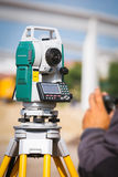 Surveyor equipment tacheometer or theodolite outdoors at construction site Stock Photos