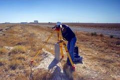 Surveyor. Geodetic surveyor installs the GPS equipment in the desert Betpakdala stock images