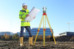 Surveyor on a hill holding a Plan roll in hands. A Surveyor on a hill holding a Plan roll in hands Stock Images