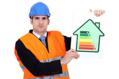 Surveyor holding energy  poster. Surveyor holding energy rating poster Stock Photography