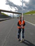 Surveyor with levelling staff Royalty Free Stock Photo