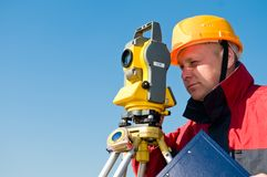 Surveyor Looking At The Thedolite Stock Photos