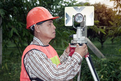 Surveyor making setting prism reflector on the field. Surveyor or Engineer making setting prism reflector on the field stock photos