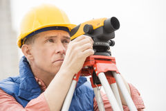 Surveyor Measuring Distances Through Theodolite Royalty Free Stock Photos
