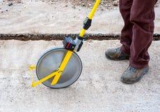 Surveyor with measuring wheel (odometer) Stock Photos