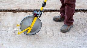 Surveyor with measuring wheel (odometer) Royalty Free Stock Images
