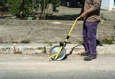 Surveyor with measuring wheel (odometer) Royalty Free Stock Photography