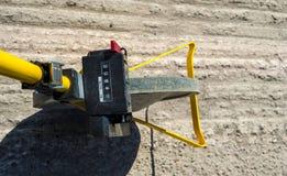 Surveyor with measuring wheel (odometer) Royalty Free Stock Photos