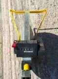 Surveyor with measuring wheel (odometer) Royalty Free Stock Image