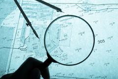 Surveyor's plan, circle and loupe with backlight Stock Photos