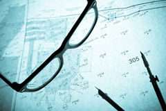 Surveyor's plan, circle and retro glasses Royalty Free Stock Photography