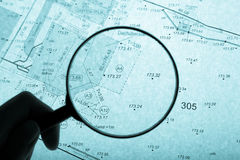 Surveyor's plan and loupe with backlight stock photos
