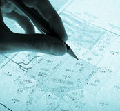Surveyor's plan and pencil with backlight Stock Images
