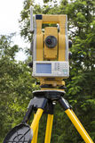 Surveyor's Robotic Total Station in the Field Stock Image
