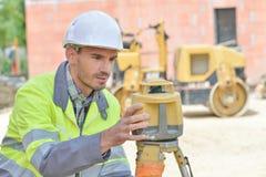 Surveyor setting up equipment Royalty Free Stock Photo