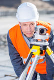 Surveyor with theodolite level. Surveyor engineer worker making measuring with theodolite equipment Stock Images