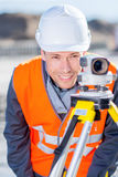 Surveyor with theodolite level. Surveyor engineer worker making measuring with theodolite equipment Stock Photo