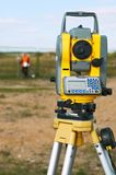 Surveyor theodolite on tripod Royalty Free Stock Image
