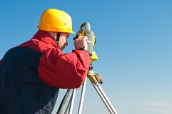 Surveyor theodolite works. Surveyor worker making measurement in a field with theodolite total station equipment Stock Image