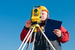 Surveyor theodolite works. Surveyor worker making measurement in a field with theodolite total station equipment Stock Photo