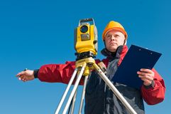 Surveyor theodolite works. Surveyor worker making measurement in a field with theodolite total station equipment Stock Images