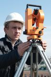Surveyor with transit level Royalty Free Stock Images