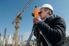 Surveyor with transit level Royalty Free Stock Photos