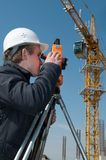 Surveyor with transit level Royalty Free Stock Photo