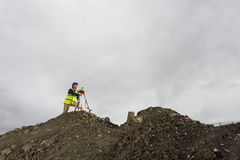Surveyor Using Theodolite At Site Royalty Free Stock Photo