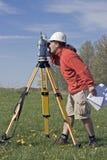 Surveyor at Work. Land Surveyor at Work, spring time stock image