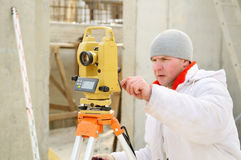 Surveyor worker at construction Royalty Free Stock Photos